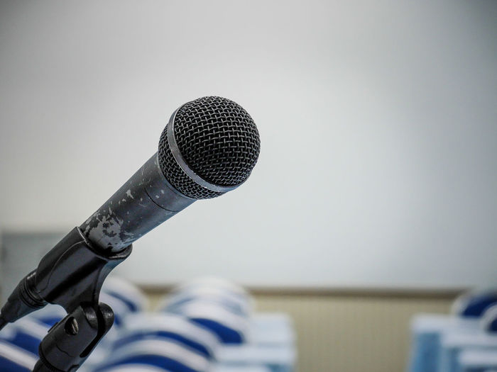 Microphone Input Device Focus On Foreground Metal Indoors  Technology Music Absence Close-up Communication Microphone Stand No People Arts Culture And Entertainment Audio Equipment Copy Space Equipment Selective Focus Speech Pattern Single Object Silver Colored Stage