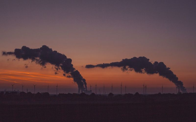 Smoke Stack Pollution Factory Air Pollution Smoke - Physical Structure Emitting Industry Sunset Silhouette Fumes Environment Chimney Clear Sky No People Tree Landscape Environmental Issues Tall Global Warming Sky