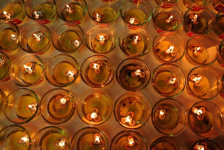 High angle view of illuminated candles on table