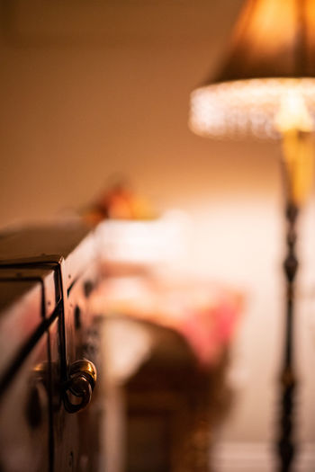 Selective Focus Indoors  Lighting Equipment Music Arts Culture And Entertainment Musical Instrument Close-up Electric Lamp No People Musical Equipment Illuminated Technology Domestic Room Focus On Foreground Home Interior Metal Still Life Wood - Material String Instrument Luxury
