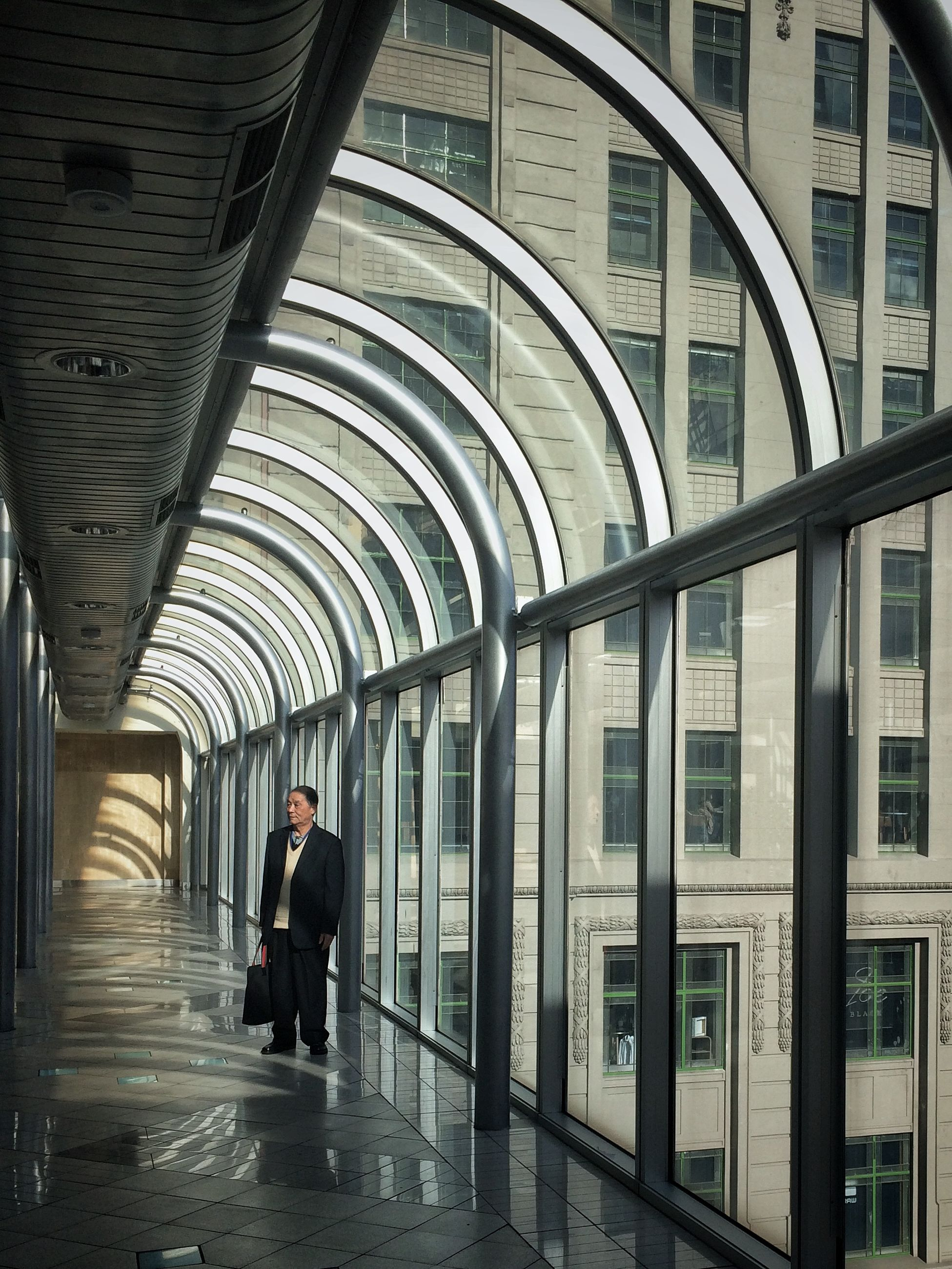 architecture, built structure, walking, men, indoors, full length, lifestyles, person, arch, rear view, building exterior, the way forward, city life, railroad station, leisure activity, city, corridor, building