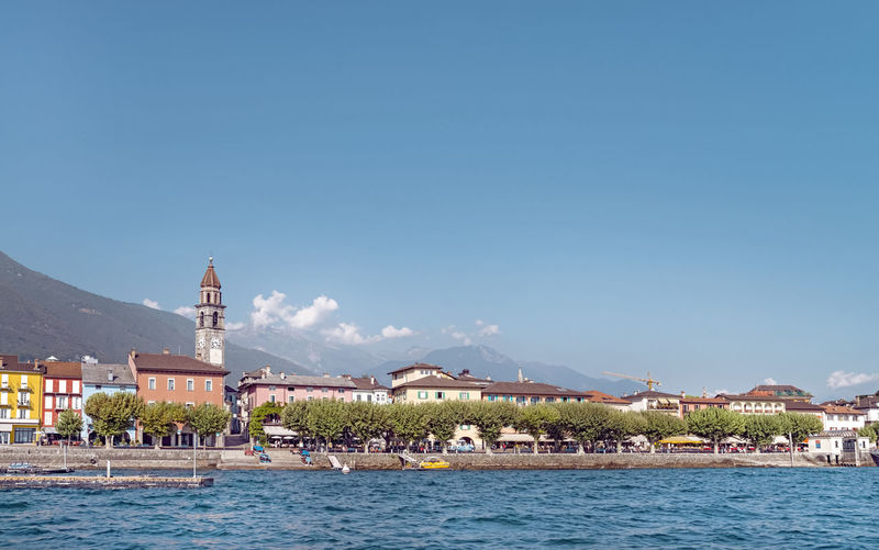 Ascona panorama from the waters of lake Maggiore Lake Maggiore Ascona, Ticino, Switzerland Panorama Water Sky Mountain Outdoors City Day Nature Waterfront Tranquil Scene Town No People Nobody Sunny Summer Travel Building Exterior Architecture Built Structure