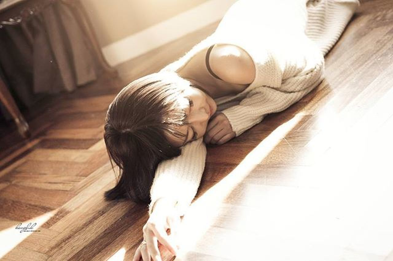 indoors, lying down, high angle view, relaxation, hardwood floor, child, home interior, people, childhood, girls, real people, young adult, young women, human body part, human back, day, adult, back, children only, human hand