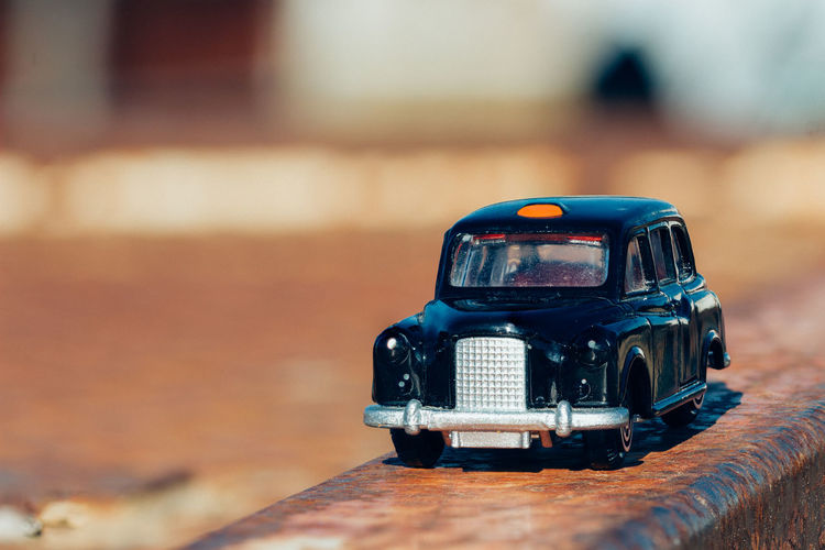 Close-Up Of Toy Car On Railing