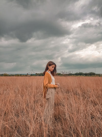 Woman standing on land against sky