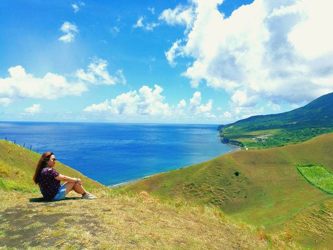 daydreaming.. Basco, Batanes Wheninbatanes BatANESSA View HillTopView Hilltop Batanes Islands Sky Clouds Daydreaming F Daydreamer Outdoors The Traveler - 2018 EyeEm Awards Water Sea Full Length Beach Women Sand Sitting Sky Horizon Over Water Cloud - Sky Seascape Island The Great Outdoors - 2018 EyeEm Awards