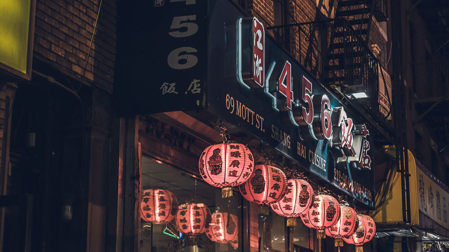 China Town (New York City) Advertisement Architecture Building Exterior Built Structure City Commercial Sign Communication Illuminated Lighting Equipment Neon Night No People Non-western Script Red Sign Store Store Sign Street Text Western Script