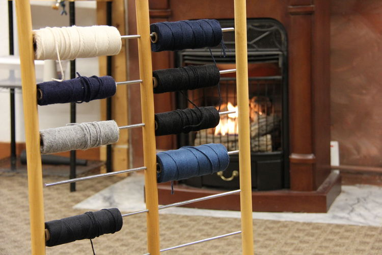Colorful spools against fireplace