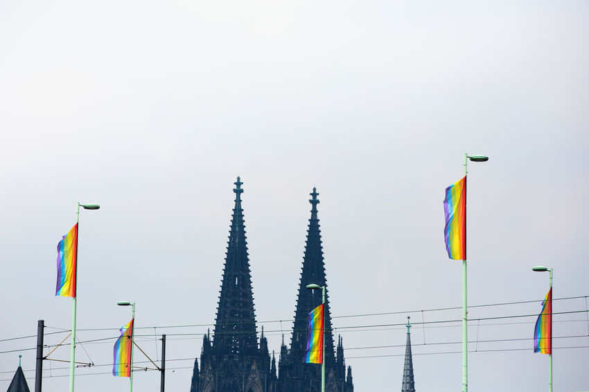 CSD Cologne , Köln,  Event Rainbow Colors Rainbow Flags Architecture Building Building Exterior Built Structure Clear Sky Cologne Cathedral Copy Space Csd Cologne 2017 Day Flag Homosexual Love Low Angle View Multi Colored No People Outdoors Pole Pride Sky Variation Waving