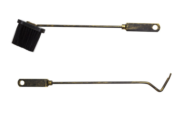 Close-up of fireplace tool set against white background