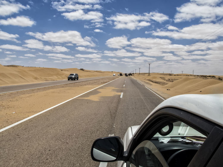 Car Cloud - Sky Day Desert Driving Journey Laayoune Landscape On The Move One Person Outdoors People Road Sky The Way Forward Transportation Travel Two Lane Highway Vehicle Mirror
