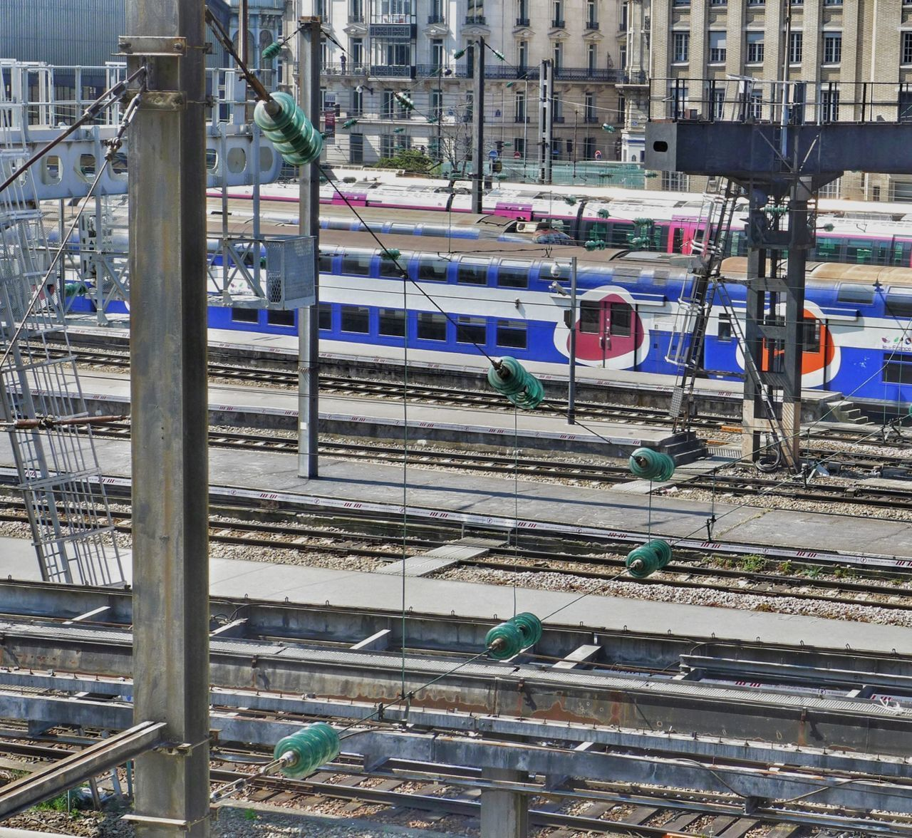 rail transportation, transportation, track, railroad track, architecture, mode of transportation, built structure, public transportation, building exterior, train, city, high angle view, day, train - vehicle, no people, land vehicle, outdoors, railroad station, connection, travel, station