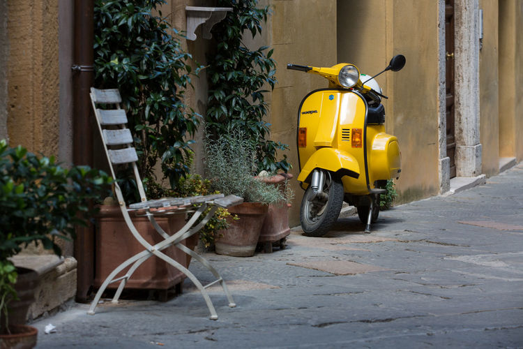 Yellow cart against wall