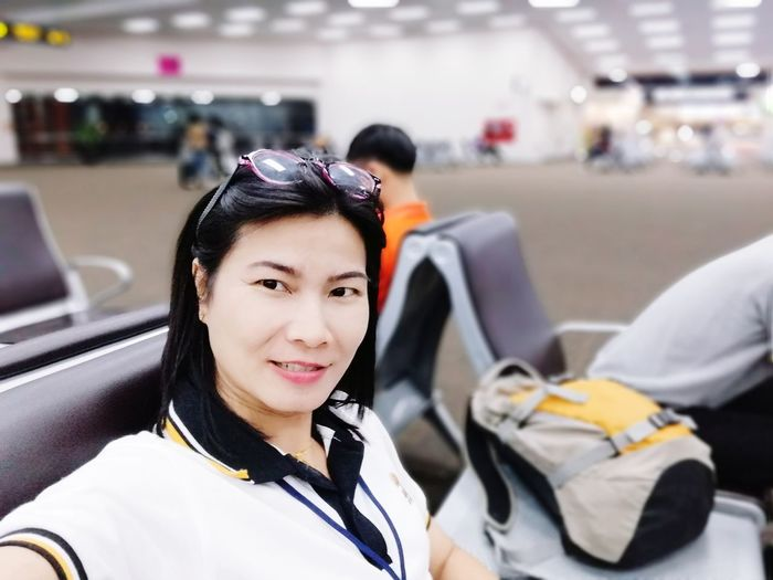 EyeEm Selects City Smiling Portrait Young Women University Student Happiness Student Airport Corporate Jet Transportation Building - Type Of Building Airplane Ticket Ticket Passport Airport Terminal Airport Departure Area Airport Runway Commercial Airplane Subway Platform Cabin Crew Arrival Departure Board Airport Check-in Counter