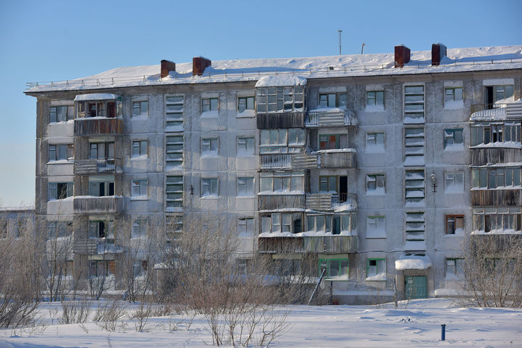 Low angle view of building against sky during winter