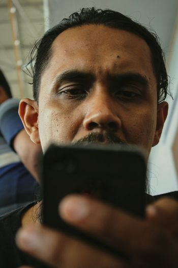 Low angle close-up of man using mobile phone