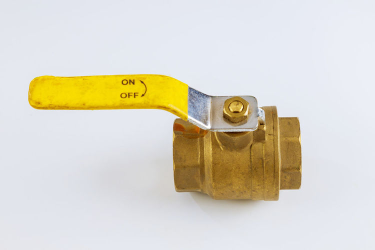 Close-up of machine part against white background