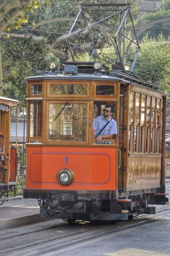 Tram of Sóller City Tree Men Land Vehicle Public Transportation Tramway Rail Transportation Passenger Train Tram Train - Vehicle Railway Track