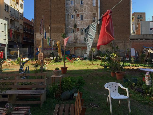 Flag Grass Building Exterior No People Outdoors Architecture Day Urban Gardening Orchard Urban Garden Chair Barcelona Adapted To The City