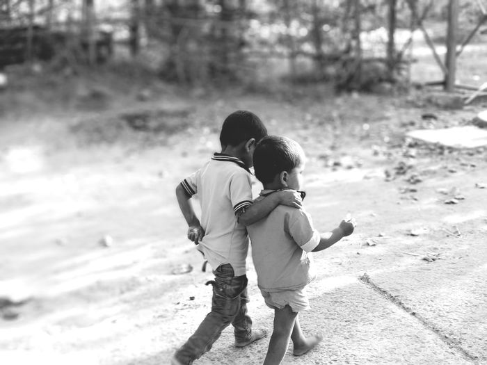 Rural Village Blackandwhite EyeEm Selects Child Childhood Full Length Togetherness Beach Males  Boys Playing Bonding Happiness Brother Babyhood