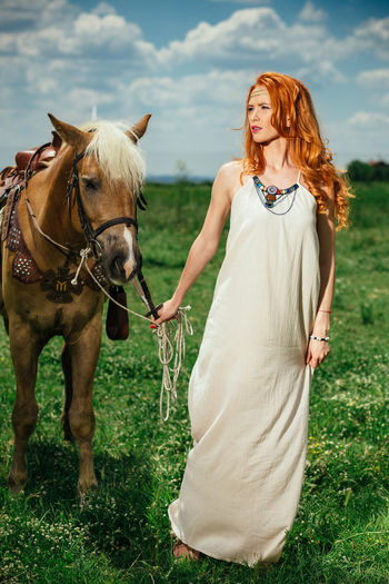 Animal Themes Before The Storm Blue Sky Bulgarian Bułgaria Canon 85mm F/1.8 Canon6d Canonphotography Domestic Animals Front View Full Length Green Horse Jinbei Hd600 One Person Portrait Portrait Of A Woman Portraits Red Hair Redhair Redhead Springtime Standing Young Women