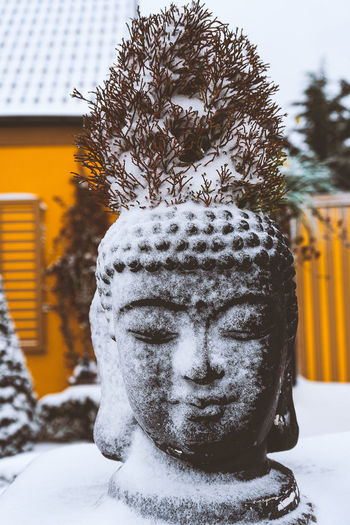 Close-up of statue against snow during winter