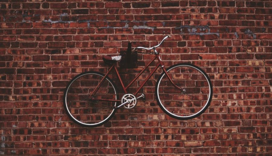 Perks of being a wall-bicycle. Adventure Antique Architecture Bicycle Brick Brick Wall Building Exterior Built Structure City Day Exploring Modern No People Outdoors Red Rustic