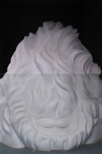 Close-up of cake against black background