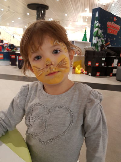 Face Painted Face Painting Blond Hair Child Childhood Close-up Color Face Paint Face Painted Child Front View Girl Happiness Indoors  Lifestyles Little Girl Looking At Camera One Person Party Party - Social Event Portrait Real People