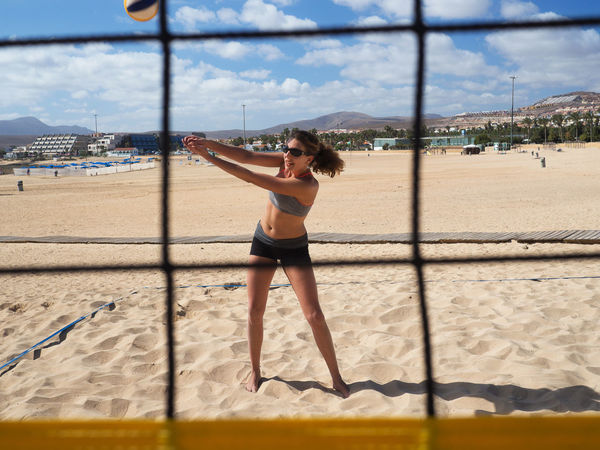 Athletic woman dredges the volleyball on the beach Fitness, Activity Attack, Attaktive, Ball Beach Beach Volleyball Beachball Beautiful Bump Dig Female, Hit Jump Matches Net Outdoor Outdoors Play Recreation, Sport Sports Sportswear, Volleyball Woman