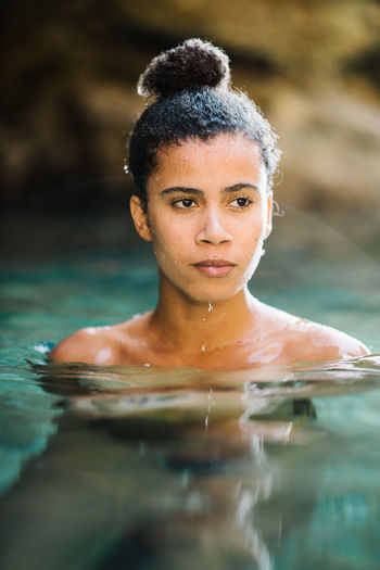 Thoughtful Young Woman Swimming In Sea