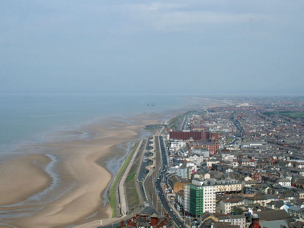 aerial view of blackpool looking south showing the beach at low tide with the roads and buildings of the town stretching down the coast to the irish sea on the horizon Blackpool Aerial View Architecture Beach Beachphotography Building Building Exterior Built Structure City Cityscape Day High Angle View Horizon Horizon Over Water Land Nature No People Outdoors Sea Sky Skyscraper Water