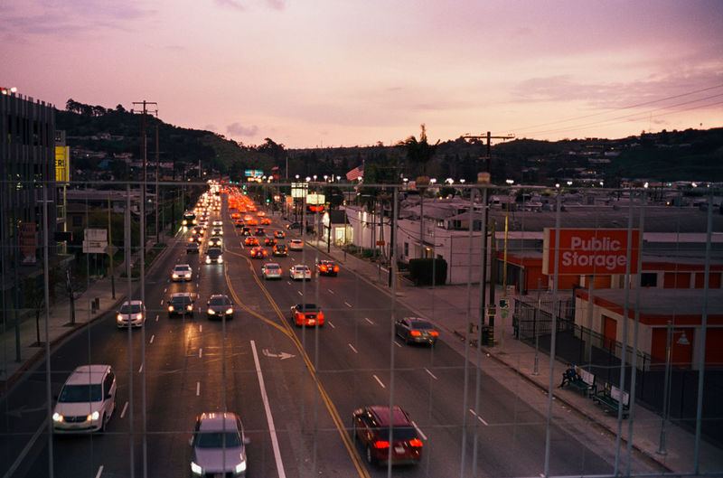 High angle view of traffic on road at sunset
