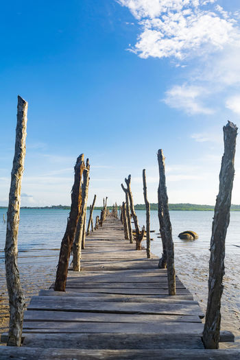 Seascape Landscape Nature Backgrounds Outdoors Colors Blue Sky Water Sea Beach Wood - Material Horizon Over Water Pier Wooden Post Scenics Tranquil Scene Padlock Tranquility Calm Countryside Non-urban Scene Idyllic Mooring Post Moored Jetty Groyne Underneath Stilt House Shore Streaming