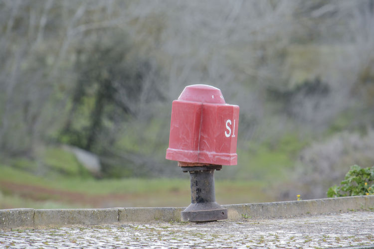 Close-up of red water pipe on metal