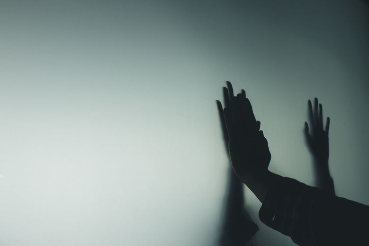 Cropped image of hand over black background