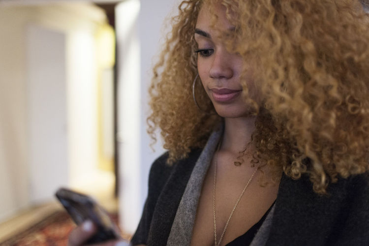 Portrait of young woman using smart phone