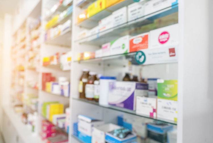 Blurry view of drug store and pharmacist. Blurred clean pharmacy with medicine on shelves. Defocus white drugstore Large Group Of Objects Choice Indoors  Refrigerator No People Retail  Variation Shelf Store Communication Selective Focus Appliance Text Container Multi Colored Arrangement Still Life Business Close-up Box Consumerism Packet