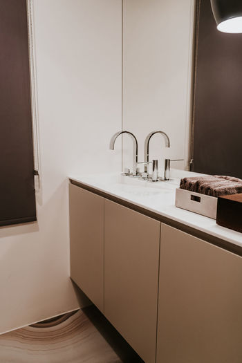 Indoors  Sink Faucet Domestic Room No People Home Home Interior Modern Hygiene Household Equipment Bathroom Architecture Domestic Bathroom Home Showcase Interior Luxury Lighting Equipment Furniture Flooring Wealth Built Structure Tiled Floor