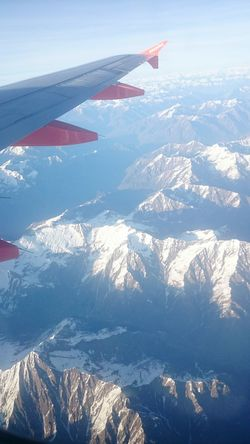 Transportation Mode Of Transport Airplane Aircraft Wing Flying Air Vehicle Cropped Travel Mountain Part Of Scenics Landscape Journey Mid-air Aerial View On The Move Snowcapped Mountain Mountain Range Plane View Plane Window Mountains Mountain View Day Beauty In Nature Snow