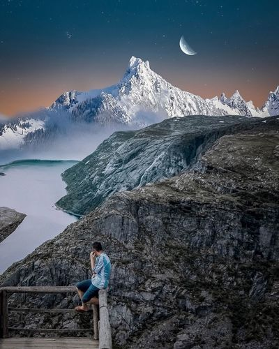 Edit Composition One Person Real People Leisure Activity Beauty In Nature Lifestyles Scenics - Nature Nature Sky Mountain Men Star - Space Winter Snow Standing Water Casual Clothing Space Full Length Astronomy Outdoors