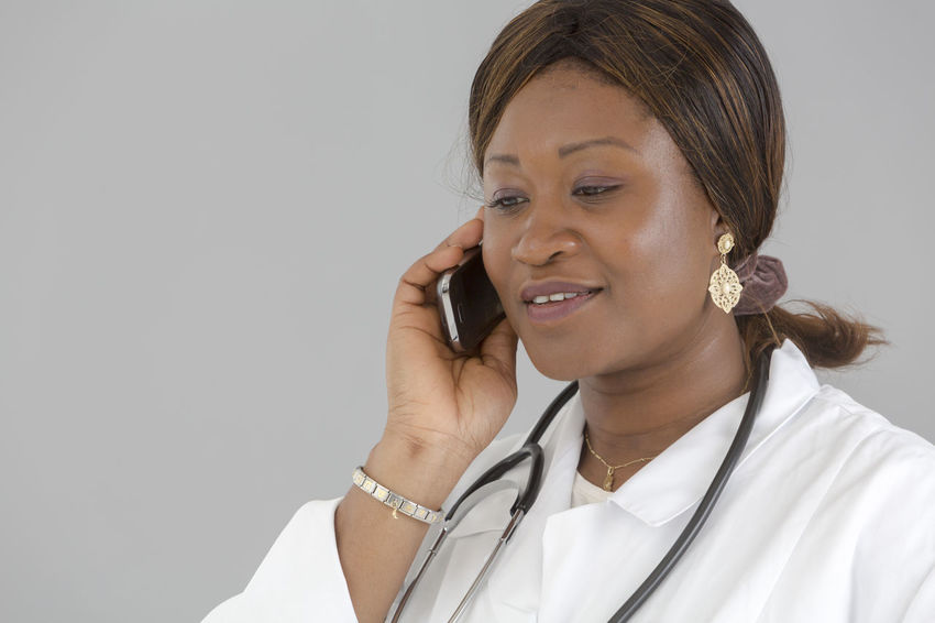 Stethoscope  Medical Nurse Doctor  Hospital Pediatrics Pediatrician Clinic White Background Occupation Good News Reassurance Reassuring Beautiful Woman African Smiling Portrait Speaking On The Phone Talking On The Phone African Girl  Diagnosis