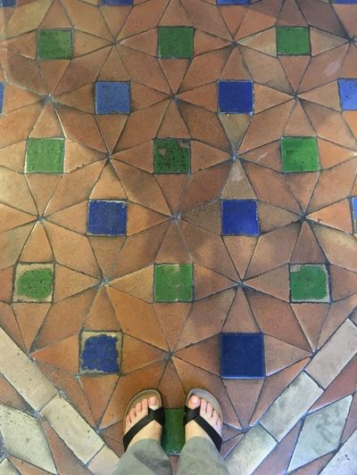 High Angle View Standing Personal Perspective Low Section Human Leg Multi Colored Pattern Indoors  Ancient Floor Medieval Architecture