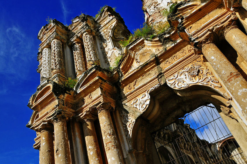 Ruined Catholic church in Antigua, Guatemala Architecture Catholic Church Ancient Architectural Column Architecture Belief Building Building Exterior Built Structure Day History Low Angle View Nature No People Old Ornate Outdoors Place Of Worship Ruined Sky The Past Tourism Travel Travel Destinations