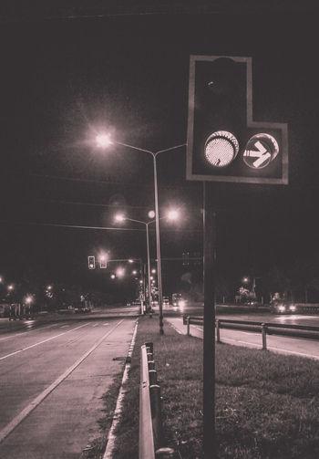Street lights on road at night