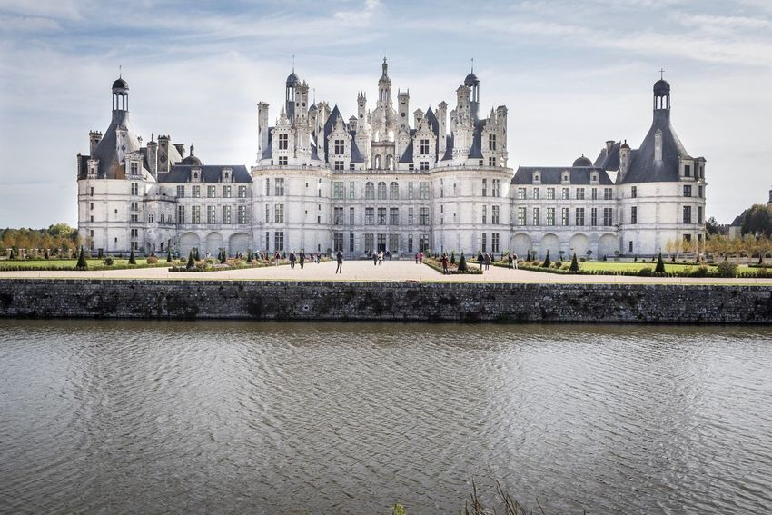 Chambord Chambord Castle Chateau De Chambord Architecture Built Structure Building Exterior River Water Travel Destinations Sky Outdoors Government Cloud - Sky Waterfront Tourism Travel Bridge - Man Made Structure City Day Dome No People Cityscape Politics And Government Welcomeweekly EyeEmNewHere