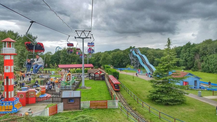 Fun At The Fair Fairground Attraction Fairground Fairground Rides Sky And Clouds Chairlifts Slides Train Rides Dramatic Sky