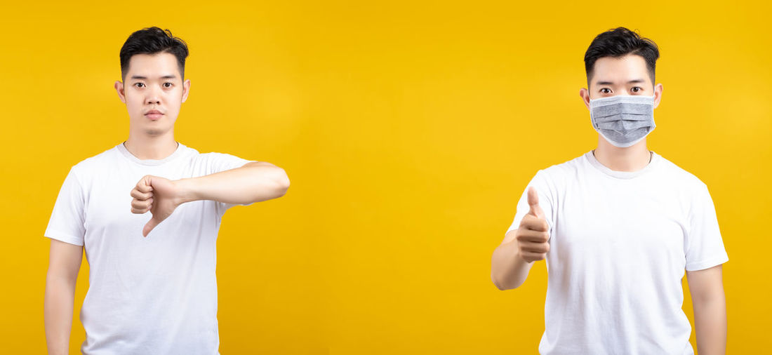 Portrait of friends standing against yellow background