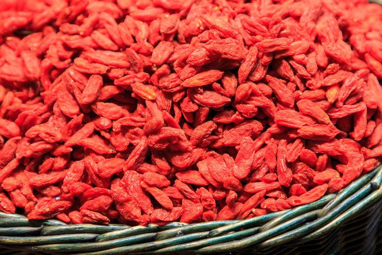 Pile of goji berries in wicker basket