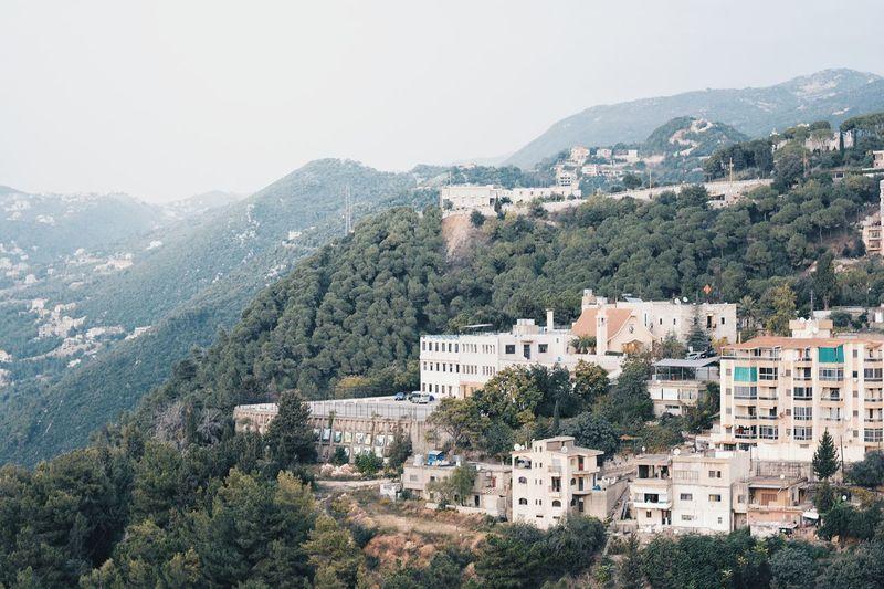 Houses On Mountain Against Clear Sky